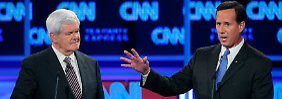 Bei der CNN-Debatte im Oktober 2011 wurde Santorum (r.) kaum wahrgenommen - das hat sich geändert.
