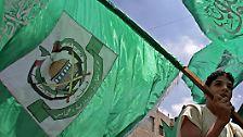 Das Wappen der Hamas zeigt zwei gekreuzte Schwerter, den Felsendom und eine Karte des historischen Palästina - also Gazastreifen, Westjordanland und heutiges Israel.