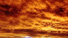 """Das chemische Zeichen """"Au"""" vereint Visionen und Hoffnungen. Es steht für Aurora, den """"leuchtenden Morgen""""."""