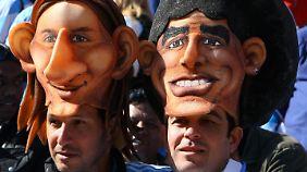 Argentiniens Fußballfans vergöttern beide: Messi und Maradona.
