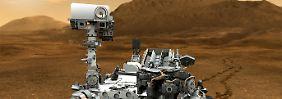 """Die Grafik zeigt """"Curiosity"""" bei der Arbeit auf dem Mars."""