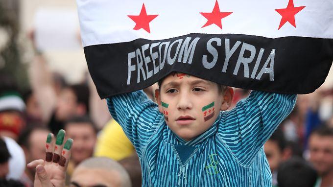 Im jordanischen Amman feiern Menschen den zweiten Jahrestag des Beginns des Aufstands.
