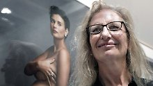 Leibovitz vor einer ihrer bekanntesten Bilder, der schwangeren Demi Moore.