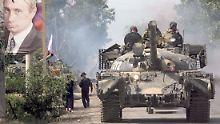Ein russischer Panzer beim Einmarsch in der südossetischen Hauptstadt Zchinwali im August 2008.