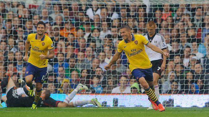 """""""Jeder in der Mannschaft liebt Podolski"""", sagt Arsenal-Coach Wenger über seinen Doppeltorschützen gegen Fulham."""