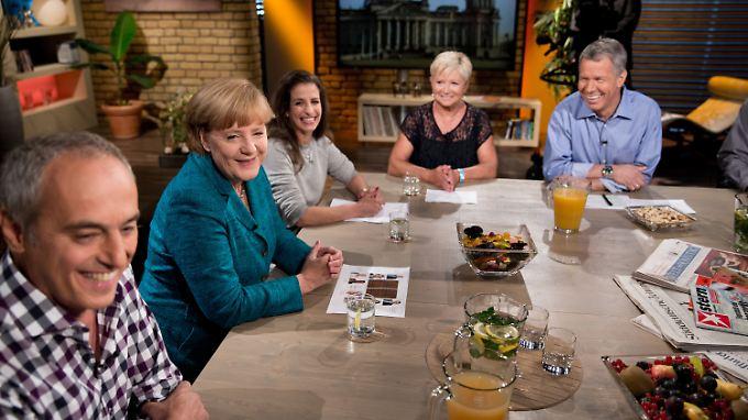 An einem Tisch mit Angela Merkel: Kanzlerin trifft auf besorgte Wähler