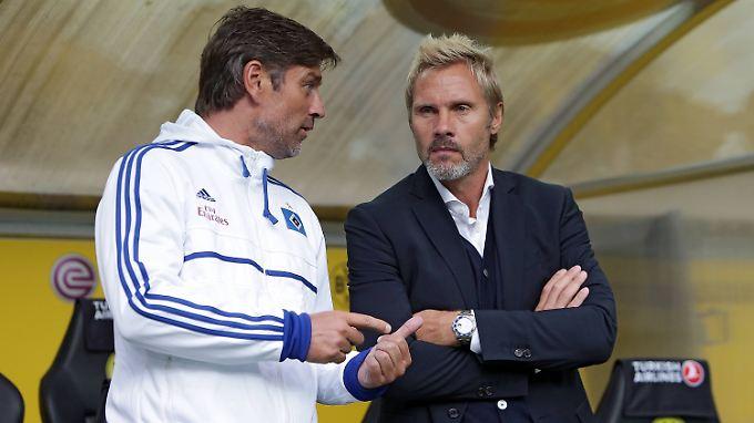 """""""Das Thema Trainer stellt sich für mich Stand heute nicht."""" Sagt Oliver Kreuzer, links, über Thorsten Fink."""