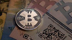 Wechselkurs fährt Achterbahn: Bitcoin knackt 1000-Dollar-Marke
