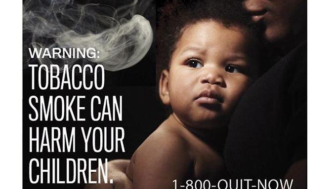 Aufhören und Hotline anrufen: Der Hinweis auf einer US-Zigarettenpackung warnt davor, dass Tabakrauch auch die eigenen Kinder schädigen kann.
