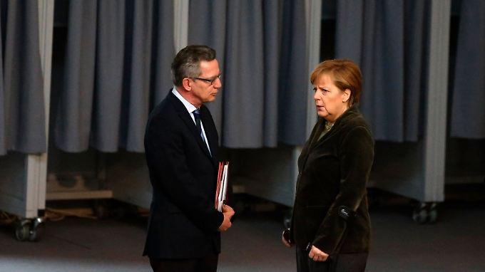 Enge Vertraute: De Maiziere und die Kanzlerin.
