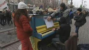 """Trauer auf dem Maidan: """"Piano-Extremist"""" spielt für die Toten"""