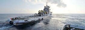 Die Suchgebiete sind riesig, die Erfolgsaussichten gering: Chinesische Bergungsschiffe im Südchinesischen Meer.