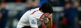 Liverpools Torjäger Luis Suarez trauert.