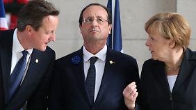 Cameron, Hollande und Merkel sind sich einig: Die EU muss Russland mit Sanktionen strafen.