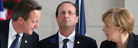 Zusammenarbeit oder Sanktionen: Merkel, Hollande und Cameron drohen Putin