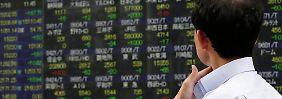 Chinas Konjunkturdaten stützen: Nikkei runter, Shanghai Composite rauf