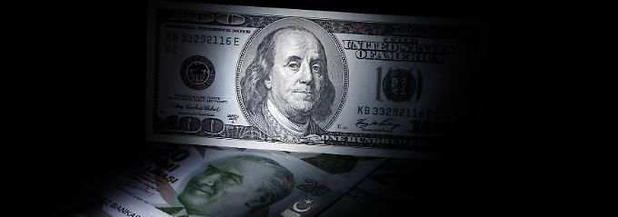 Zwei Männer mit hoher Stirn: Auf der 100-Dollar-Note prangt dasm Konterfei von Benjamin Franklin, der 20-Lira-Schein (vorn) trägt das Antlitz von Mustafa Kemal Atatürk.