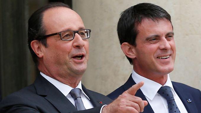 Hollande (l.) hat gepokert und gewonnen. Sein Premier Valls (r.) haut die Störer aus dem Amt.