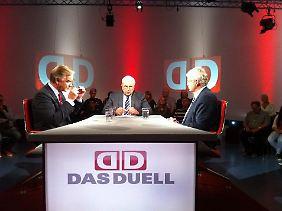 Heiner Bremer im Gespräch mit Dietmar Bartsch (l.) und Karl-Georg Wellmann (r.).