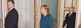 Poroschenko, Merkel und Putin mit gebührendem Abstand.