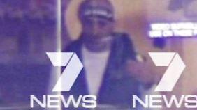 """Der Geiselnehmer, gefilmt aus den Büroräumen von """"7 News""""."""