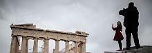 Für Touristen ist Athen noch immer eine wundervolle Stadt - selbst im Regen.