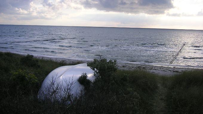 Strand, Boot und Wolken: was braucht man mehr?