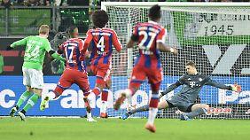 Wolfsburgs Kevin de Bruyne (l) erzielt das Tor zum 3:0. Foto