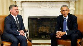 """""""Mit Wut und Trauer haben wir die Nachricht vernommen"""": Jordaniens König Abdullah II. (l.) erfährt während seines Staatsbesuch bei US-Präsident Barack Obama vom Tod der Geisel."""