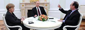 Video: Merkel, Hollande und Putin überarbeiten Friedensplan