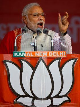 Premierminister Narendra Modi will bei den Indern mit gute Zahlen glänzen.