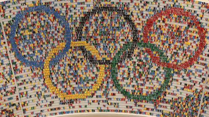 In Hamburg und in Berlin hoffen Sportbegeisterte auf die Spiele. Doch es regt sich auch Widerstand.