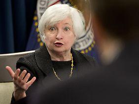 Janet Yellen wies auf Turbulenzen an den Finanzmärkten und bei ausländischen Volkswirtschaft hin.