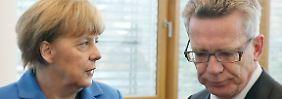 """""""Selbstverständlich hat er das"""": Merkel spricht de Maizière das Vertrauen aus"""