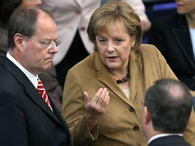 Mit Peer Steinbrück arbeitete die Kanzlerin während der Finanzkrise sehr eng zusammen. Sie garantierten den Deutschen die Sicherheit ihrer Spareinlagen.