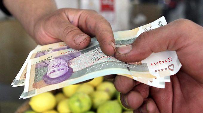 Der Iran hofft nach dem Ende der Sanktionen auf einen Wirtschaftsaufschwung - doch es gibt bereits neue Strafmaßnahmen.