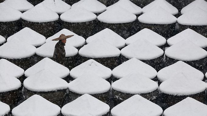 In Teilen Chinas wurden am Wochenend die niedrigsten Temperaturen seit Beginn der Wetteraufzeichnungen registriert.