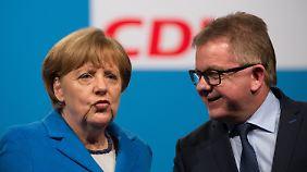 Kanzlerin Angela Merkel freut sich über die Unterstützung von Grünen-Ministerpräsident Winfried Kretschmann. Wählen sollen die Menschen im Ländle aber Guido Wolf (r.) und die CDU.