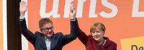 """""""Wir wollen die Zahl reduzieren"""": Merkel verteidigt ihren Flüchtlingskurs"""
