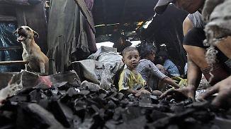 Geld über Gesundheit: Mutter trauert Kohlehölle von Manila nach