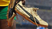 Usain Bolt lief 2008 in Peking in goldenen Schuhen zu Gold - das stärkt die Marke Puma indirekt.
