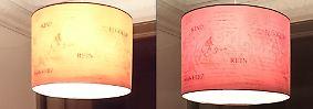 ... das Xperia macht eher ein gelbliches Licht daraus. Deutlich zu sehen: Beim iPhone-Foto (r.) sind viel mehr Details erkennbar.