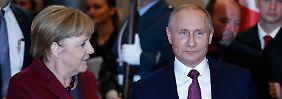 Handschlag ohne Augenkontakt: Merkel fand klare Worte für Putins Syrien-Linie.