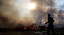 """""""Das ist so Tradition unter Flüchtlingen"""": """"Dschungel"""" von Calais geht bei Räumung in Flammen auf"""