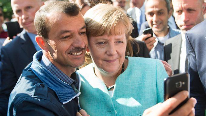 Ein Selfie, das um die Welt ging. Stimmt. Auf die Zahl der Flüchtlinge in Deutschland hatten Bilder wie diese aber einen geringeren Einfluss als viele dachten.