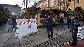 Schweigeminuten und Betonklötze: Weihnachtsmärkte bleiben bundesweit geöffnet