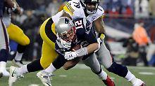 Quarterback Tom Brady (silberner Helm) von den New England Patriots spielt seinen siebten Super Bowl.