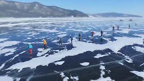 Wettbewerb bei klirrender Kälte: Extremsportler jagen 205 Kilometer über den Baikalsee