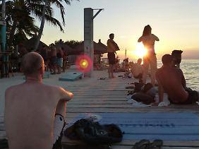 Sonnenuntergang an der Meerenge The Split: Caye Caulker überzeugt auf den zweiten Blick durch karibische Einfachheit.