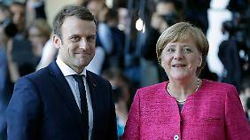 Antrittsbesuch in Berlin: Macron und Merkel loten gemeinsame Linie aus